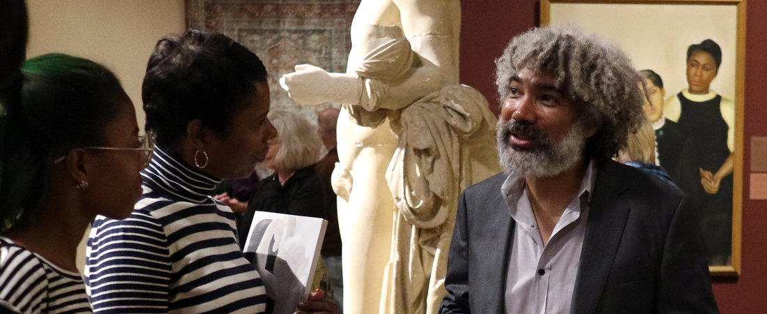 Artist and MacArthur fellow Fred Wilson speaks with students in his 2016—17 installation